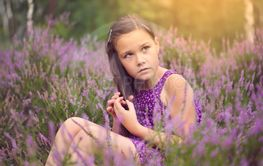 Girl in heather flowers