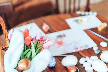 Preparing decorations for Easter. On the table are...