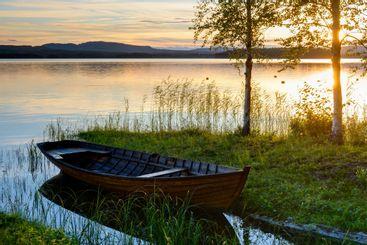 Boat at the lakeside at sunset, Solleron, Dalarna, Sweden