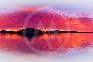 Crimson island seascape fantacy with water reflections.