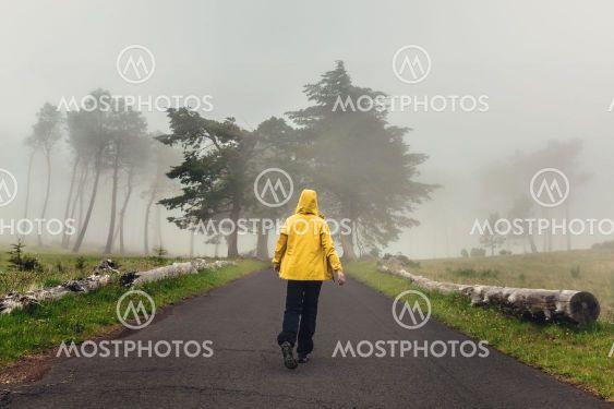 Walking on a foggy road