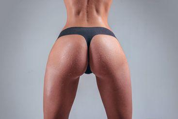 Sexy ass female in panties. Beautiful female butt. Big...