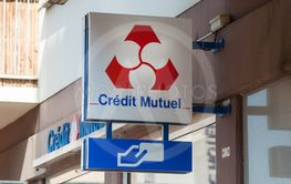 Credit mutiuel sign on bank agency facade in the street