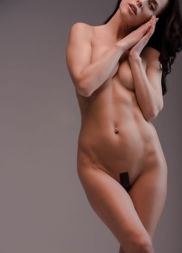 cropped view of sexy and naked woman isolated on grey