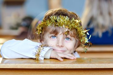 Beautiful little kid boy playing an angel in Christmas...