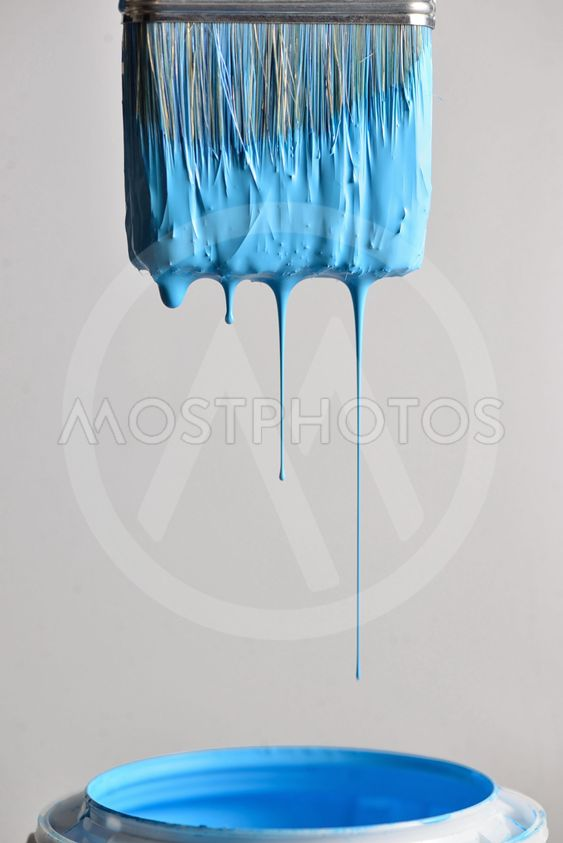 Dripping blue paint from brush
