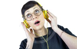 Young Woman wearing headphones listening to music