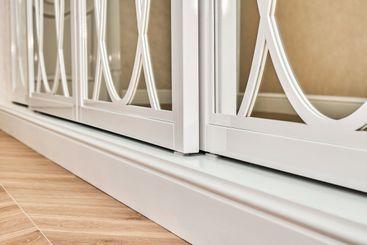 Sliding mirror wardrobe doors with overlays decor. White...