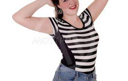 Beautiful young woman standing in shorts
