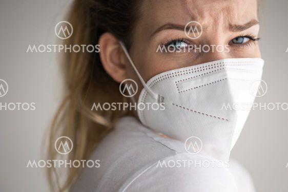Young woman wearing a face mask during coronavirus and...