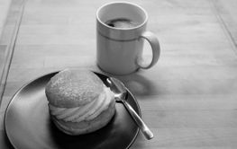 Semla and coffee, black and white image.