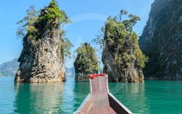 Limestone mountain ranges  with long-tailed boat at Khao...