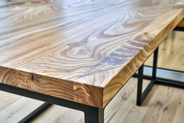 Live edge elm desk with metal base in a modern home...
