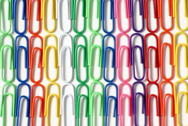 Close up of lines of color paper clips
