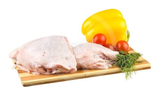 Fresh raw chicken wings on chopping board with roma...