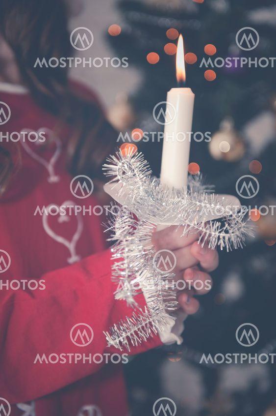 Tomteflicka med stearinljus, Lucia