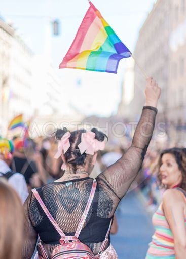 Back of a woman in black at the pride parade in Stockholm