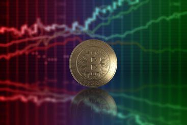 Gold coin Bitcoin on a background of business charts,...