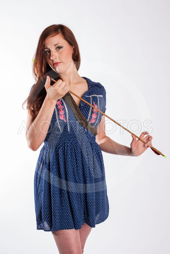 Woman with Red Hair Checks Arrow Tip