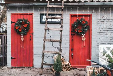 Red wooden doors in the backyard decorated with...