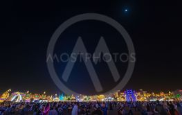The colorful skyline of Global Village during night with...