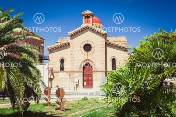 Ottimati Church in Reggio Calabria among green palms