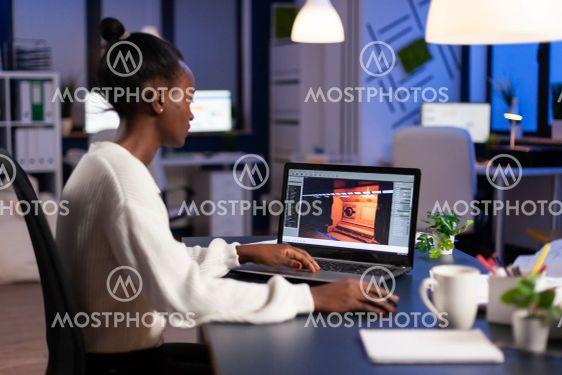 Dark skin gamer developer working at video game in midnight