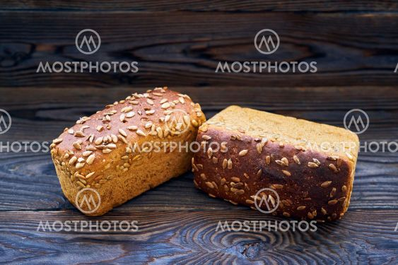 Homemade bread on dark wooden table