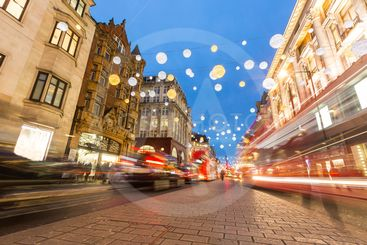 Oxford street in London with Christmas lights and blurred...