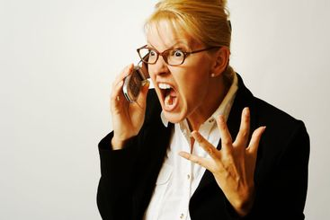 Angry Businesswoman on Cell Phone