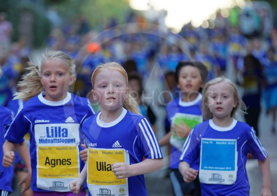 Group of young blonde girls running
