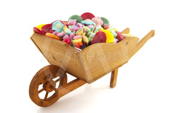 wheel barrow full with candy
