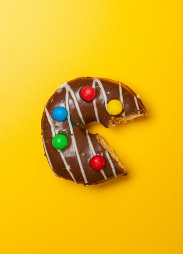 bitten chocolate vanilla donut