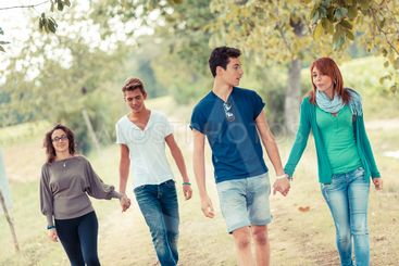 Group of Teenagers Walking Holding Hands