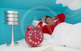 Senior woman in bed ill and suffered of sleeplessness or...