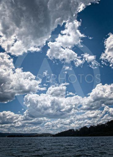 White Cumulonimbus cloud in blue sky at sea.
