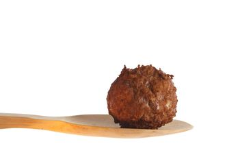 Meatball on a wooden spoon