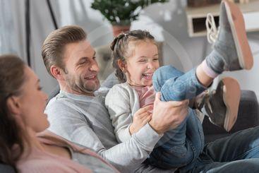 Parents having fun with daughter