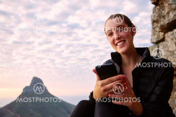 Portrait Of Young Woman Hiking Along Coastal Path...