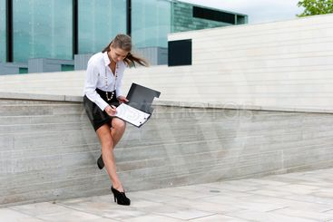 business woman sign documents on the background of a...