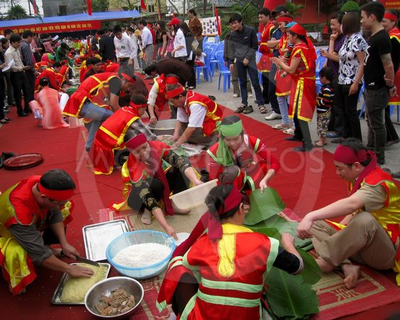 People in traditional costume exam to make square...