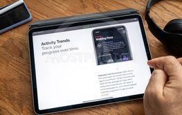 Man reading on iPad Pro WWDC 19 ios 13 activity trends