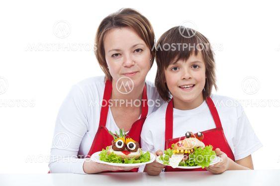Woman and boy presenting their creative sandwiches