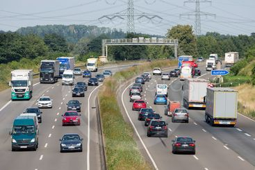 German highway with cars and trucs near city Eschweiler