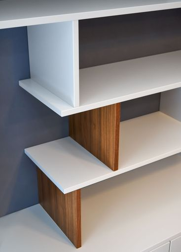 Modern bookcase. White and wooden bookshelves in...