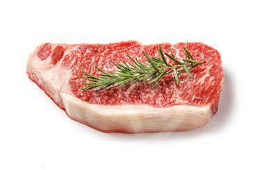 Wagyu striploin steak isolated on white