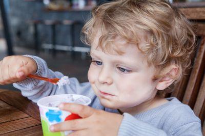 Little toddler eating ice cream summer
