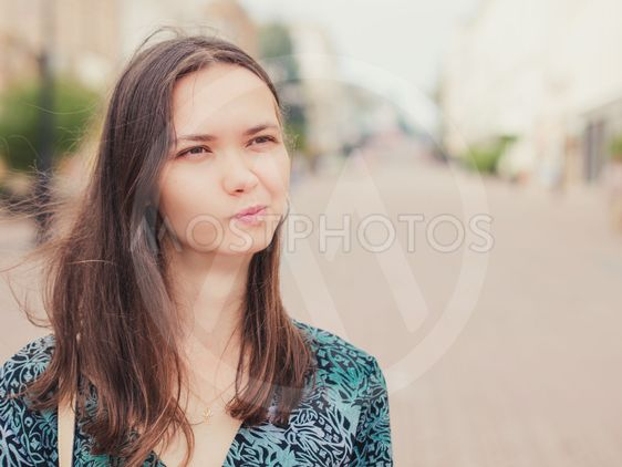 displeased handsome young woman looking away