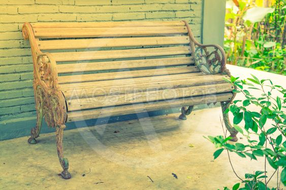 Wood Bench against brick wall .  ( Filtered image...