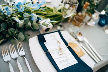 Wedding dinner table reception. A square plate with a...